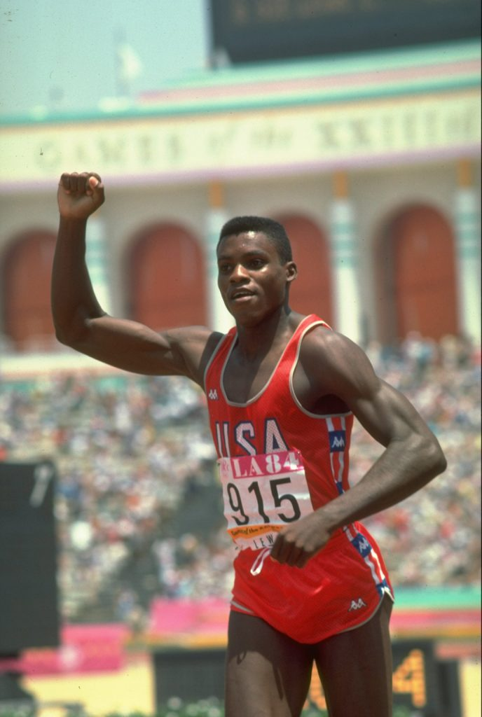Carl Lewis of the USA salutes to the crowd after winning the 100 Metres event